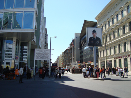 Poster is meant to symbolise the last West Berliner to man Checkpoint Charlie. On other side, East Berliner.