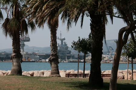Navy ships docked in the harbour.
